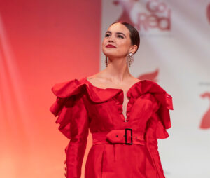 Bailee Madison wearing dress by Michael Fausto walks runway for The American Heart Association's Go Red For Women Red Dress Collection 2020