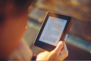 Person reading from an e book.
